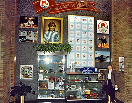 Kitty with the Wendy's wall of memorabilia in 1994