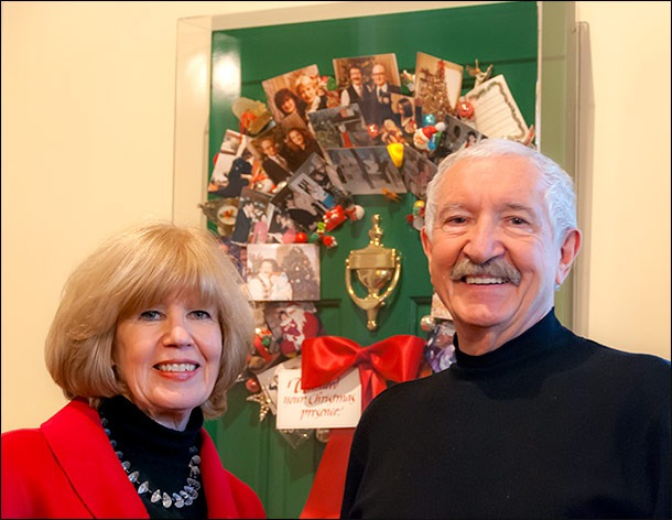 Donna and Lawrence pose with the Christmas Wreath Collage