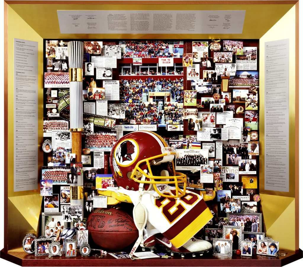 Darrell Green, Washington Redskins, retirement tribute. includes Olympic torch, football helmet, running shoes, framed family photos.
