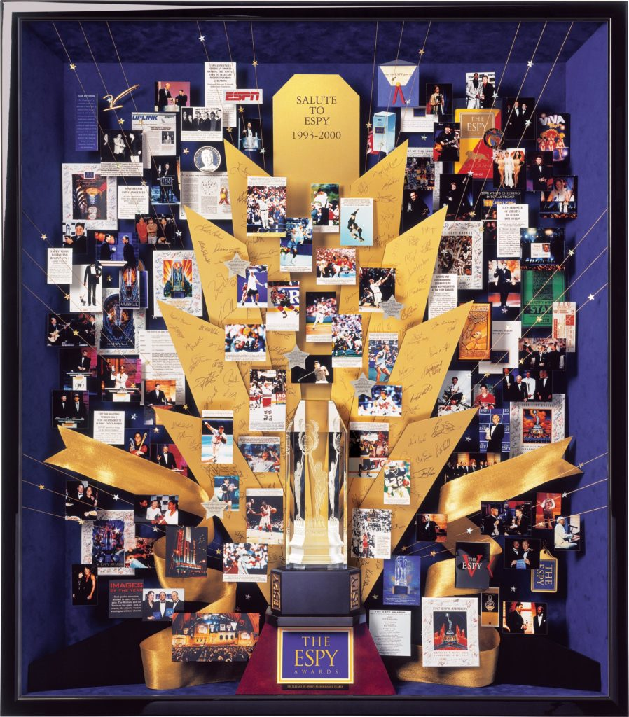 ESPY Awards collage commissioned by ESPN to celebrate 10th anniversary. Autographs of presenters are engraved in brass rays. Gold ribbons and stars add to the glamour of the Espy Awards.