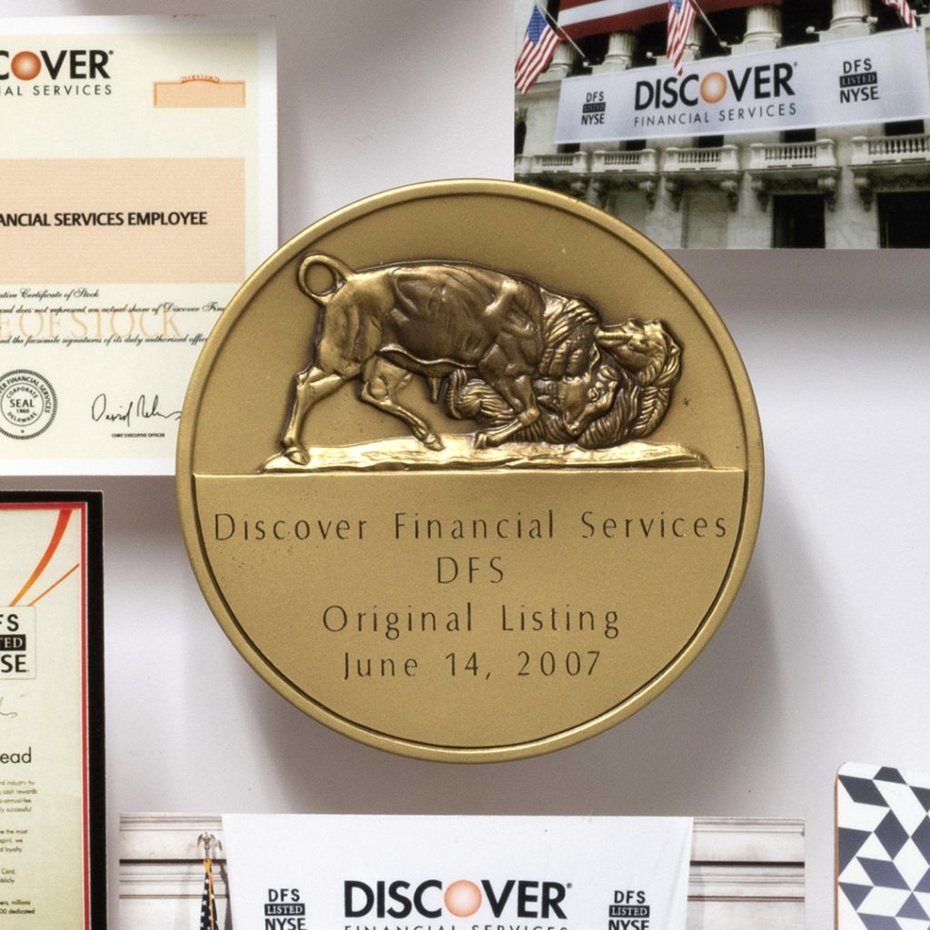 Large collage personalized with over 60 items for the CEO of Discover. Close-up showcases medallion of Discover DFS initial NYSE listing.