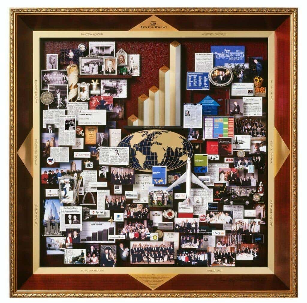 CEO retirement collage with over 100 items for Ernst and Young. Containing 3D growth chart, miniature goat, airplane, globe, blue print, dedication plaque, St. Louis Arch.
