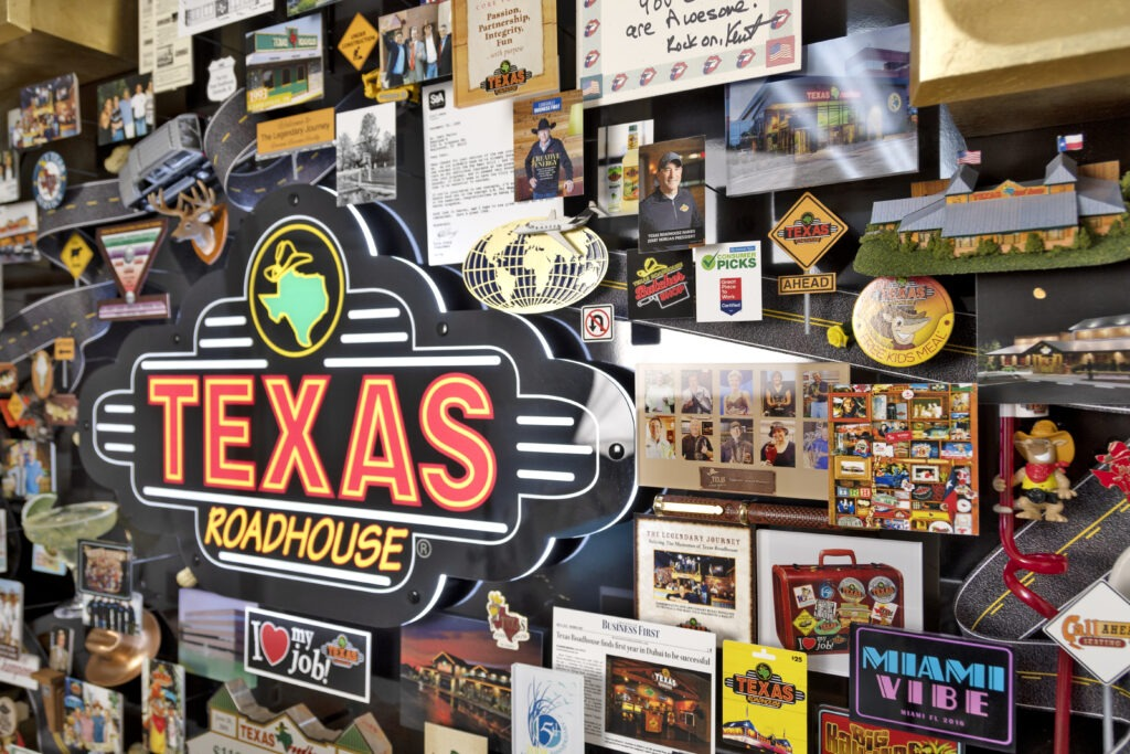 Large 3D collage for Texas Roadhouse celebrating the restaurant's story. Closeup of logo in neon lighting.