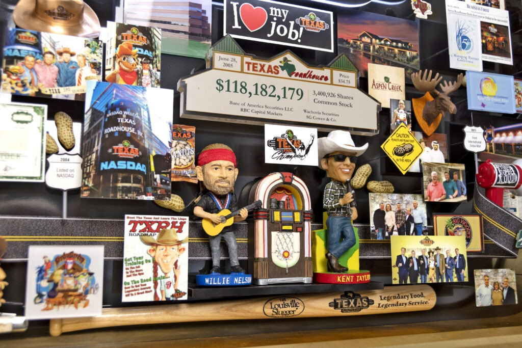 Large 3D collage for Texas Roadhouse. Bobble head of Willie Nelson and Kent Taylor next to jukebox.