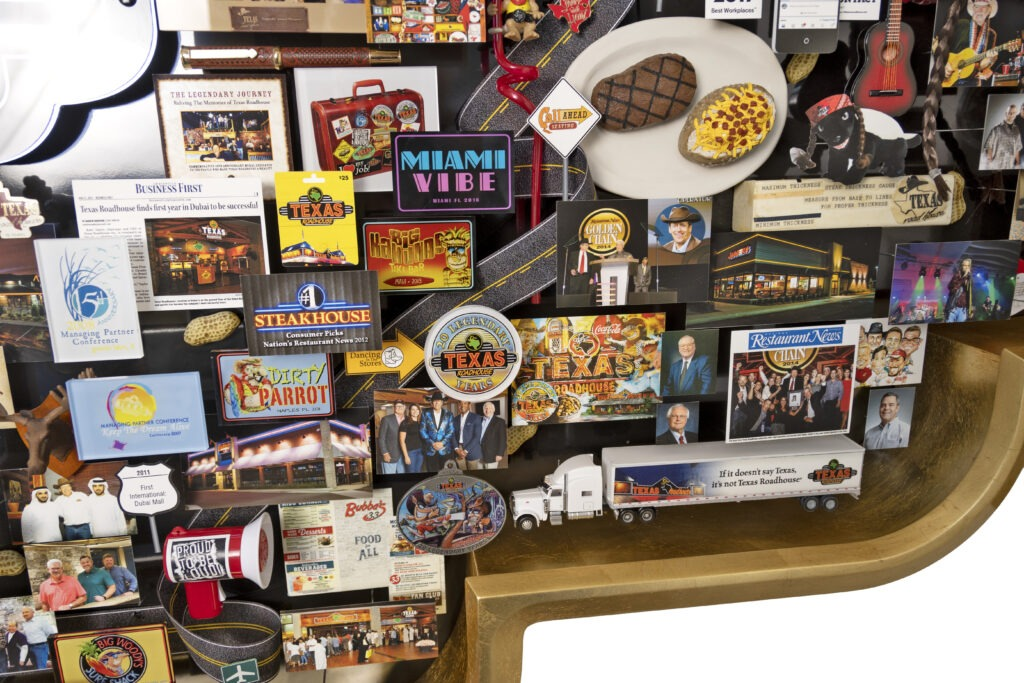 Large 3D collage for Texas Roadhouse restaurant chain. Includes steak & potatoes, truck, stick of butter.