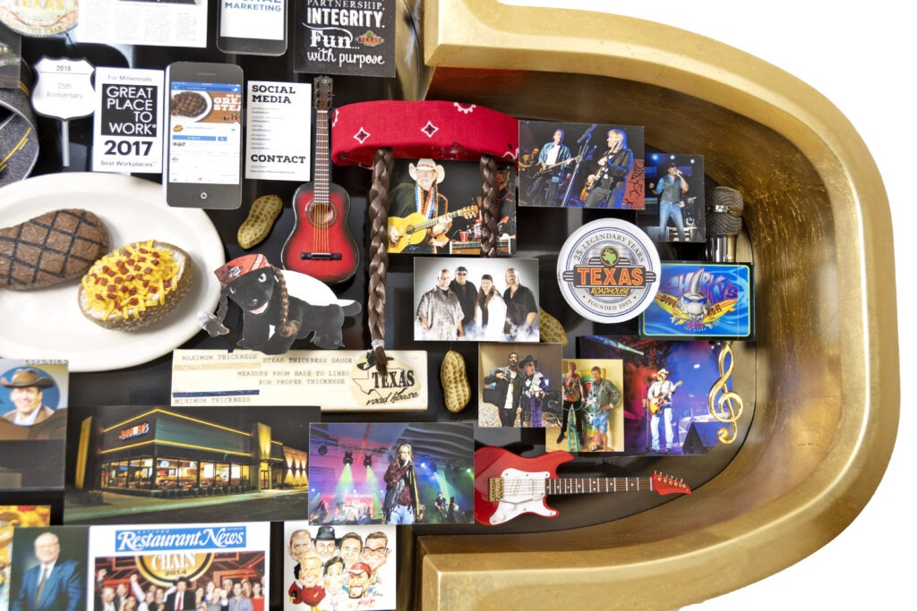 Closeup of large collage featuring miniature music related items, such as electric and acoustic guitar, microphone, and famous musicians.