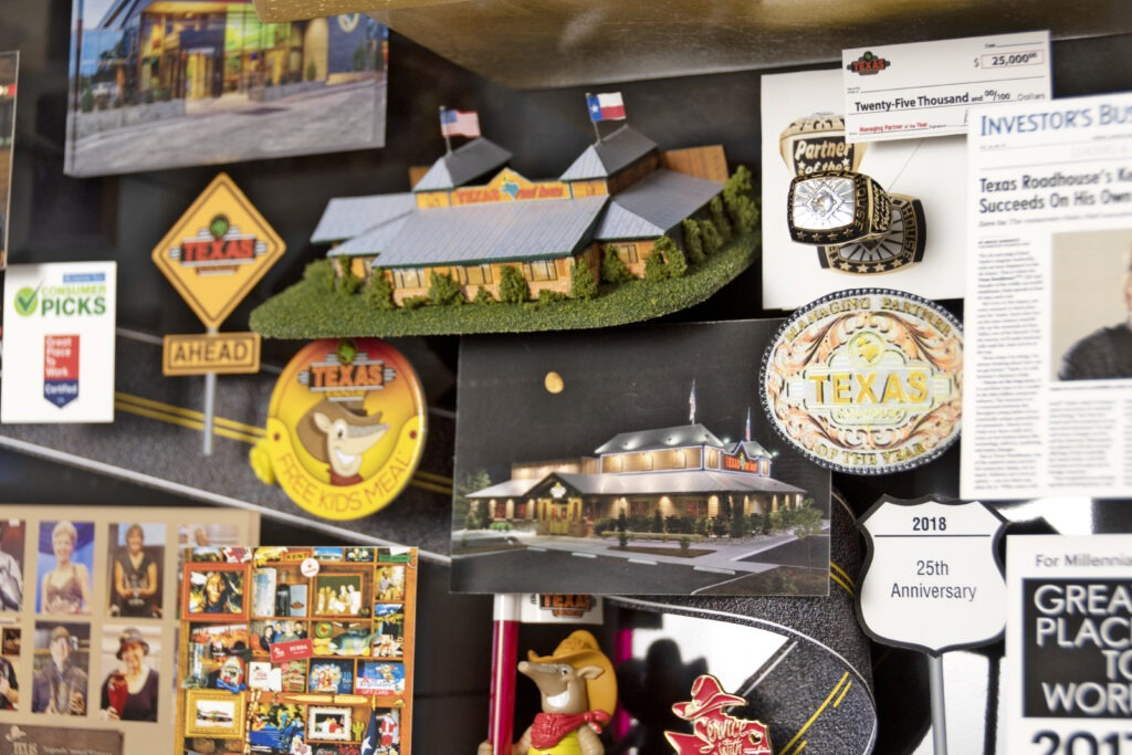 Large collage for Texas Roadhouse featuring many miniature 3D items including a replica of the restaurant.