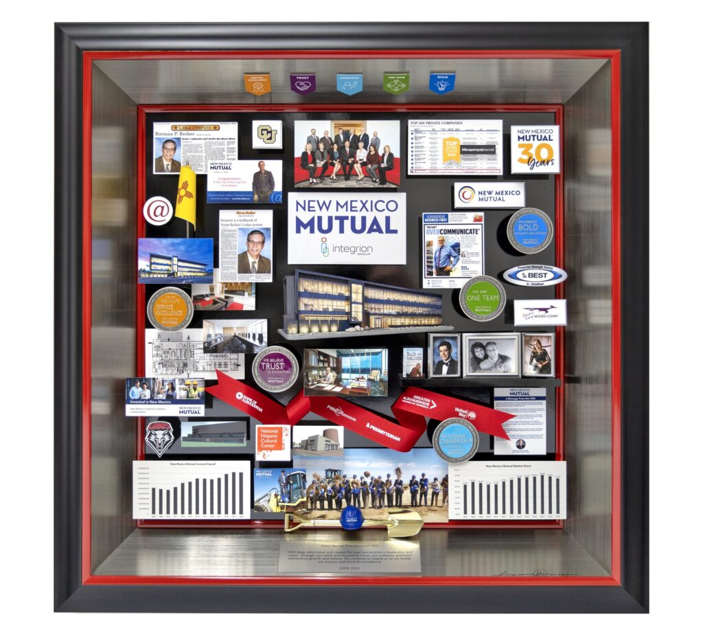 Collage containing miniaturized photos, publications, and 3D items. Includes challenge coins, mini hardhat and shovel, and ribbon.