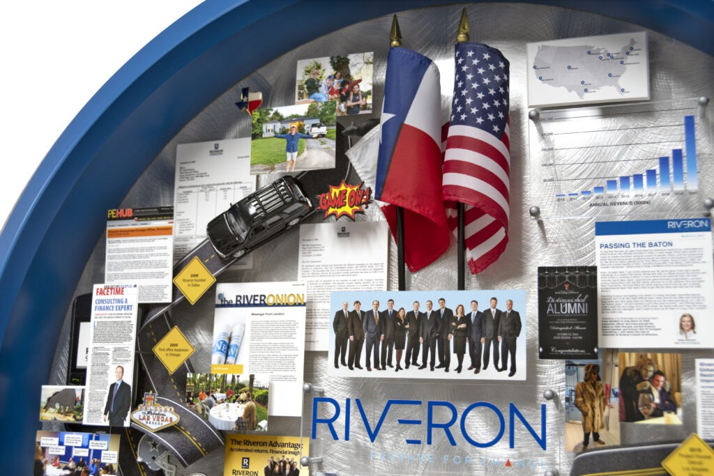 Close-up of a personalized 3-dimensional collage. Miniature items include a Texas and USA flag, Yukon truck, rat, and a Game On graphic.