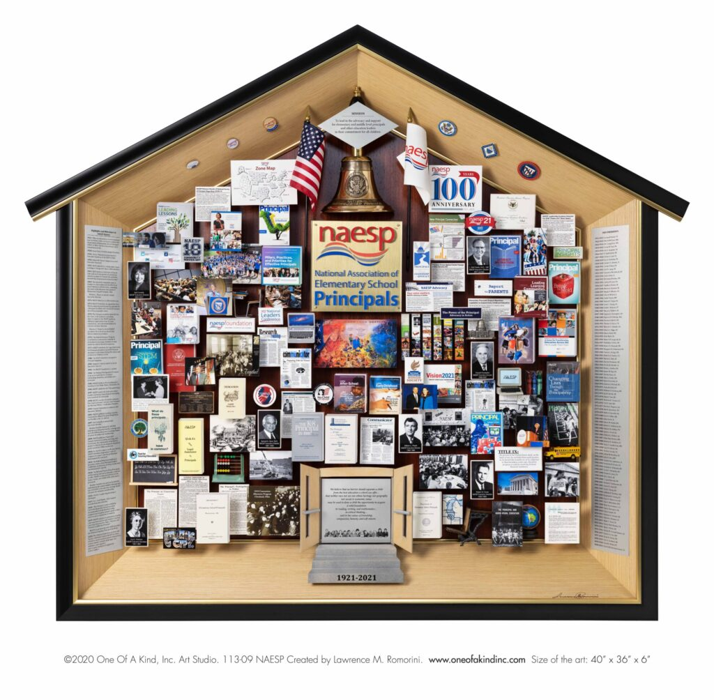 Large 3D collage with miniaturized photos, books, and 3D items including a school bus, laptop, globe, crayons, and school desk.
